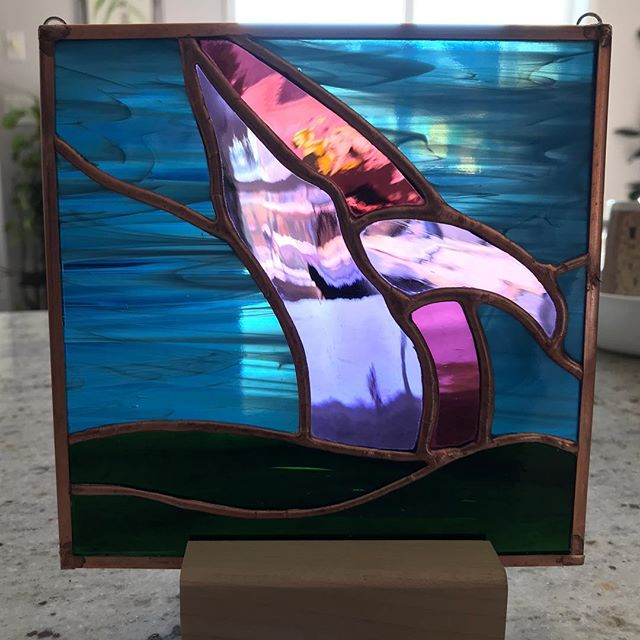 "A modified copy of a piece that I just ""sold."" And right at the last minute I out a tiny heat fracture in it. Grrrrrrrr! - - - - #stainedglass #tinyflaws #humpbackwhale #copperfoil"