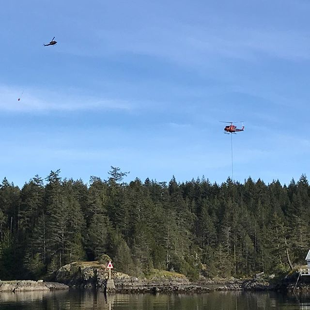 It was a quiet evening in Smuggler Cove until 2 water bombing choppers started filling up in our anchorage! Again. And again. And Again!